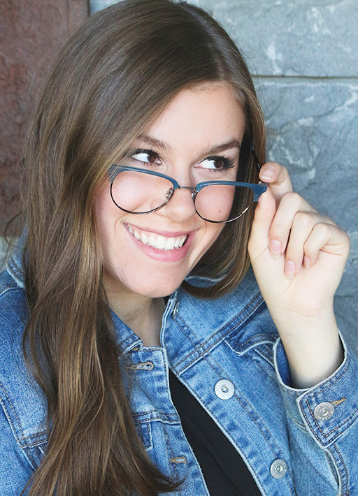 woman showing off her eyeglasses